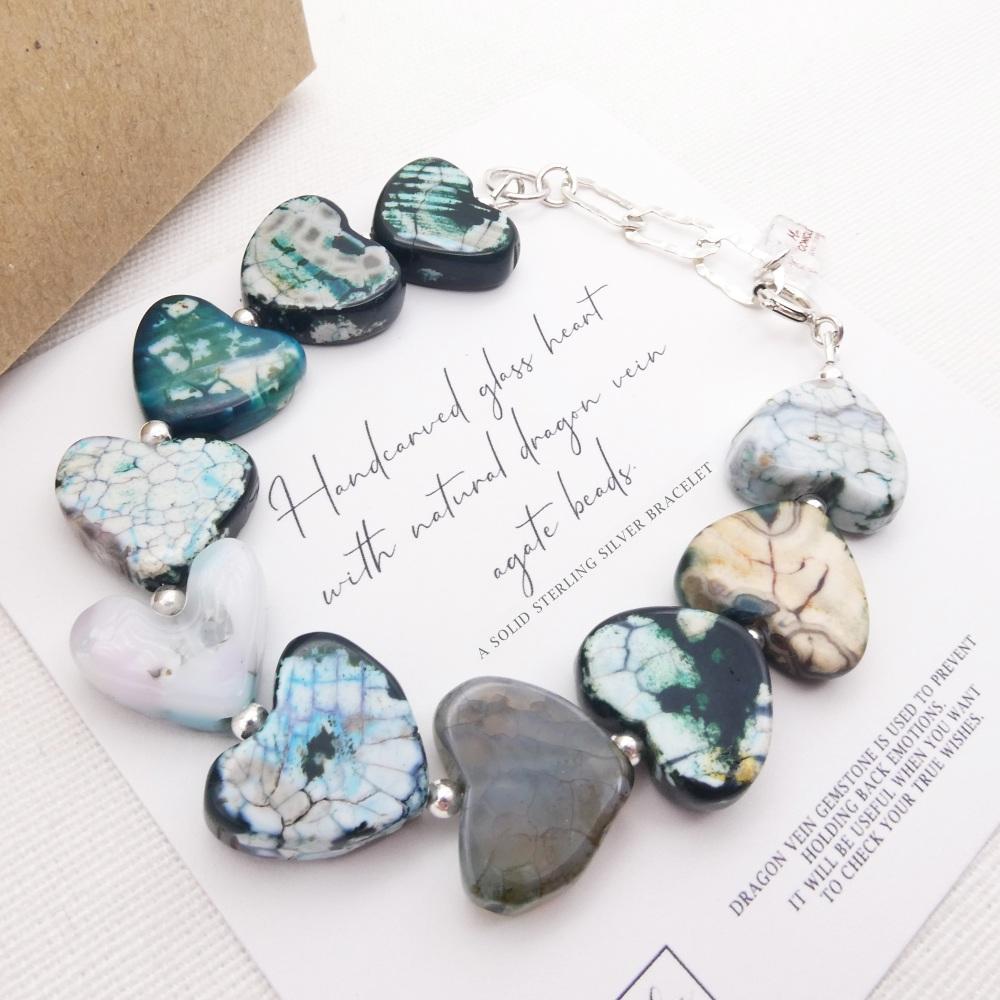 Handcarved glass heart and dragon vein gemstone bracelet.