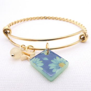 Mint Green and blue daisy Glass Tile On a Gold Plated Twisted Bangle