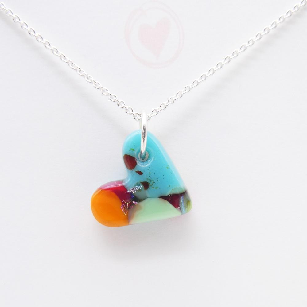 Multicoloured glass heart on silver