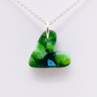 Green glass heart on silver
