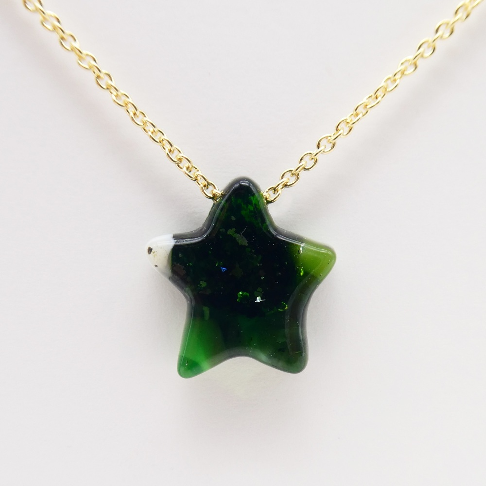 Green  Glass star on gold