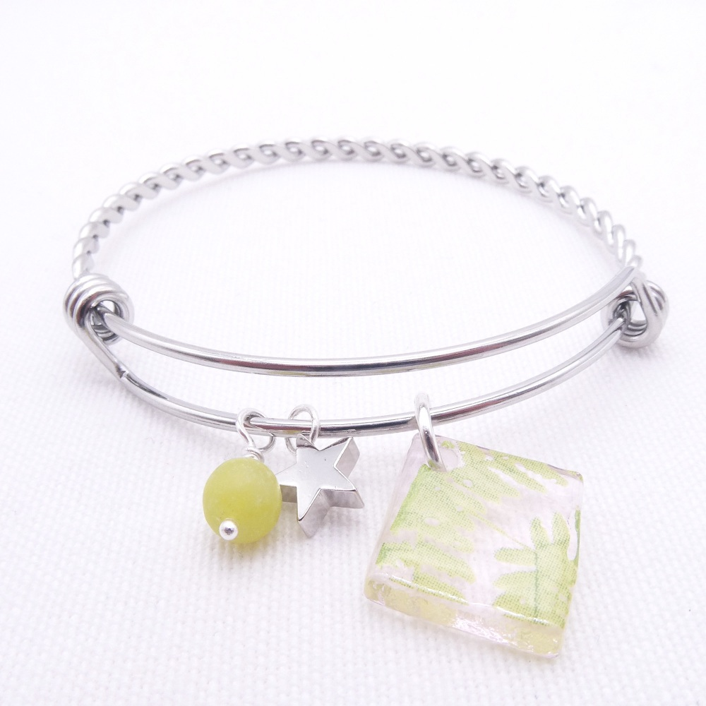 Translucent pink foliage Glass Tile On a Silver Plated Twisted Bangle