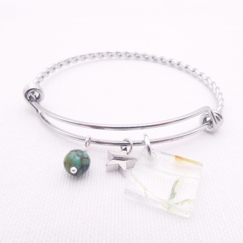 Clear Floral Glass Tile On a Silver Plated Twisted Bangle