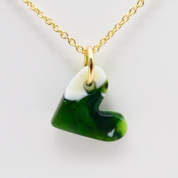 Green glass heart on filled gold