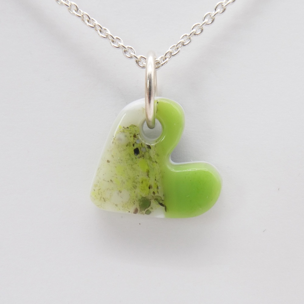 Green and white glass heart on silver