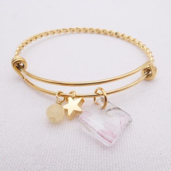 Clear Floral Glass Tile On a Gold Plated Twisted Bangle