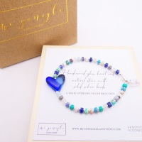 Multicoloured  natural stone bracelet on silver with a blue glass heart