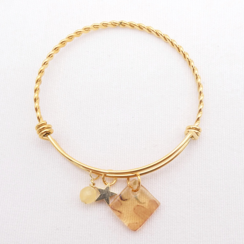 Amber floral  Glass Tile On a Gold Plated Twisted Bangle