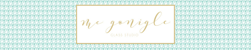 Mc Gonigle Glass Studio, site logo.