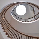 Cut string curved stair and skylight