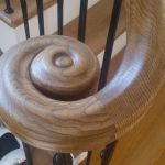 carved oak scroll on metal balusters
