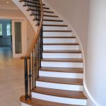 Designer curved timbber staircase with walnut treads