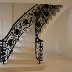 Bespoke metal balustrade and ebonised sapele handrail