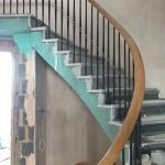 sweeping oak handrial on oval staircase