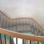 sweeping oak handrial and metal balusters on round staircase