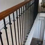 bespoke metal spindles and continous Oak handrail on stone stair