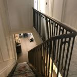 Continous Oak handrial with bespoke metal balusters