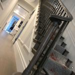 Sweeping Oak handrail, metal spindles