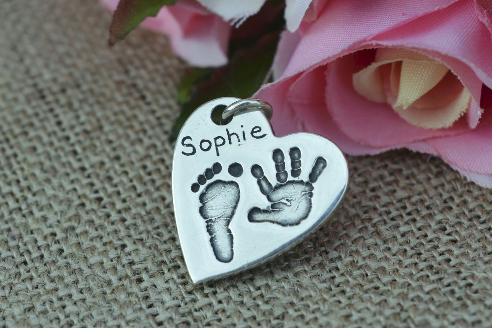 <!--002-->Handprint pendants and necklaces