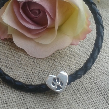 Heart shaped handprint, footprint or paw print bead on plaited leather bracelet.