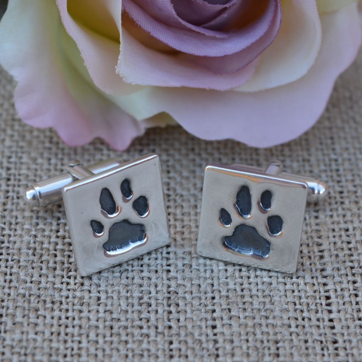 silver paw print cufflinks square