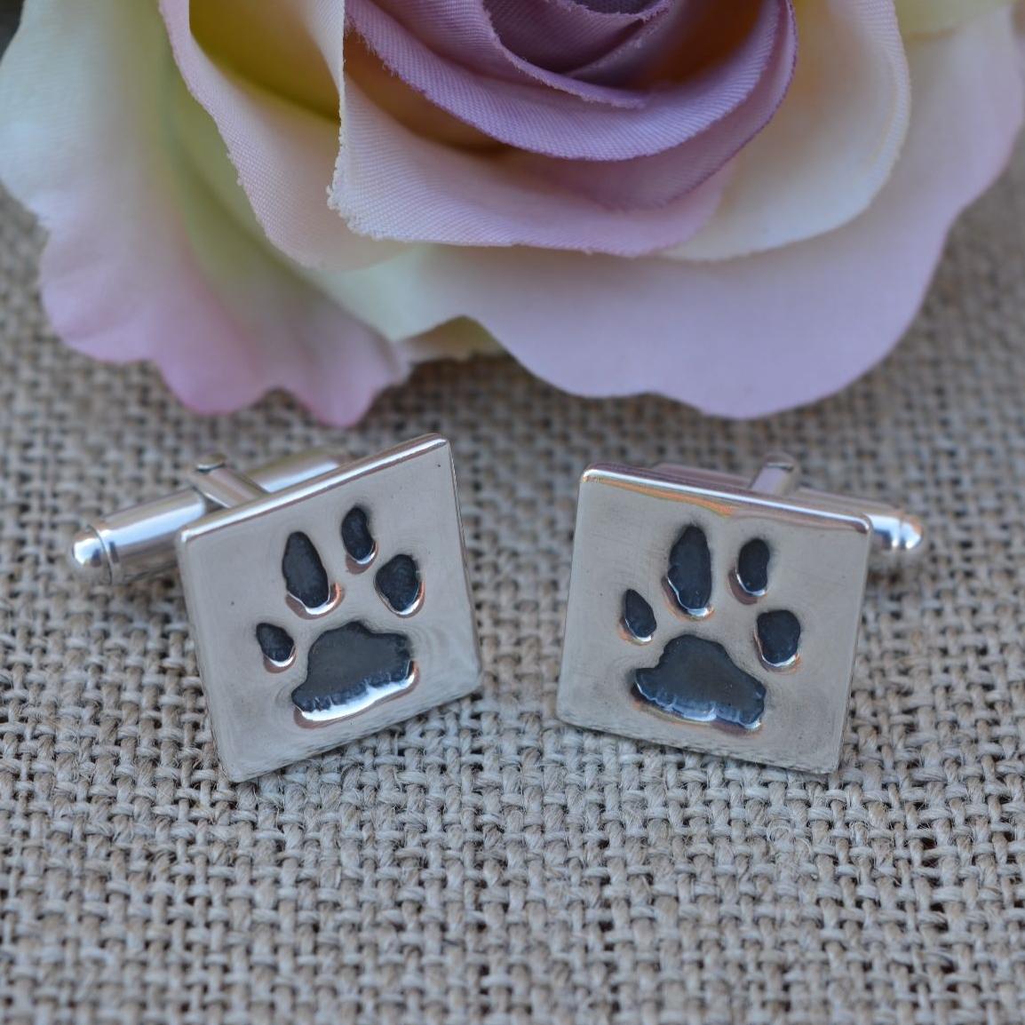 silver paw print cufflinks square
