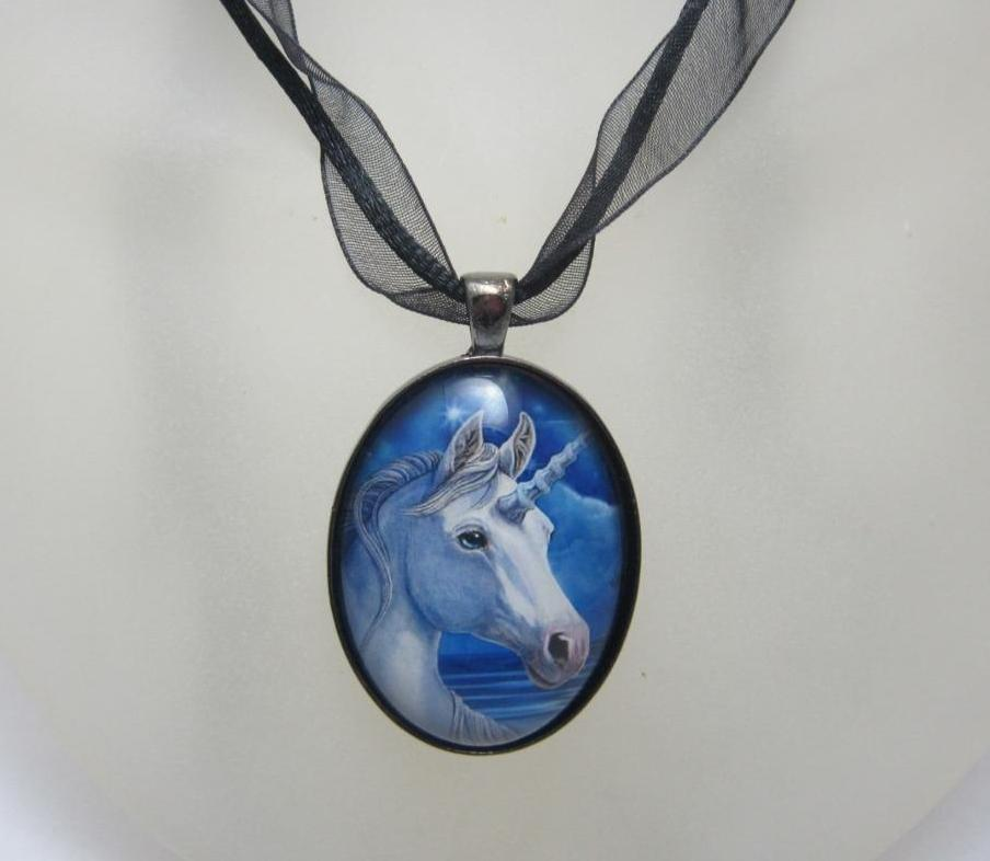 The Sacred One glass cabochon necklace by Lisa Parker