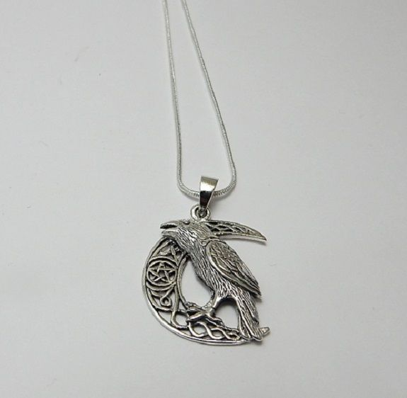 Raven on Moon necklace designed by Lisa Parker silver