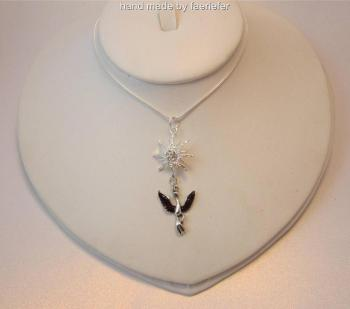 Stunning Phoenix rising necklace with crystal encrusted sun