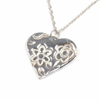 Fine silver heart on chain.