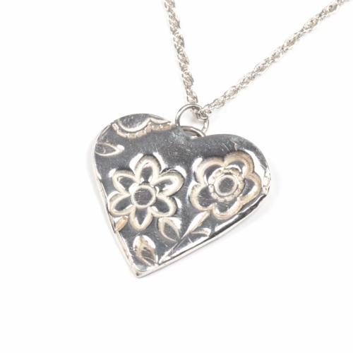 Fine silver heart on chain.