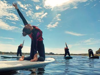 stand-up-paddleboard-yoga-half-camel-pose