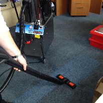 A commercial steam cleaner being used for office cleaning
