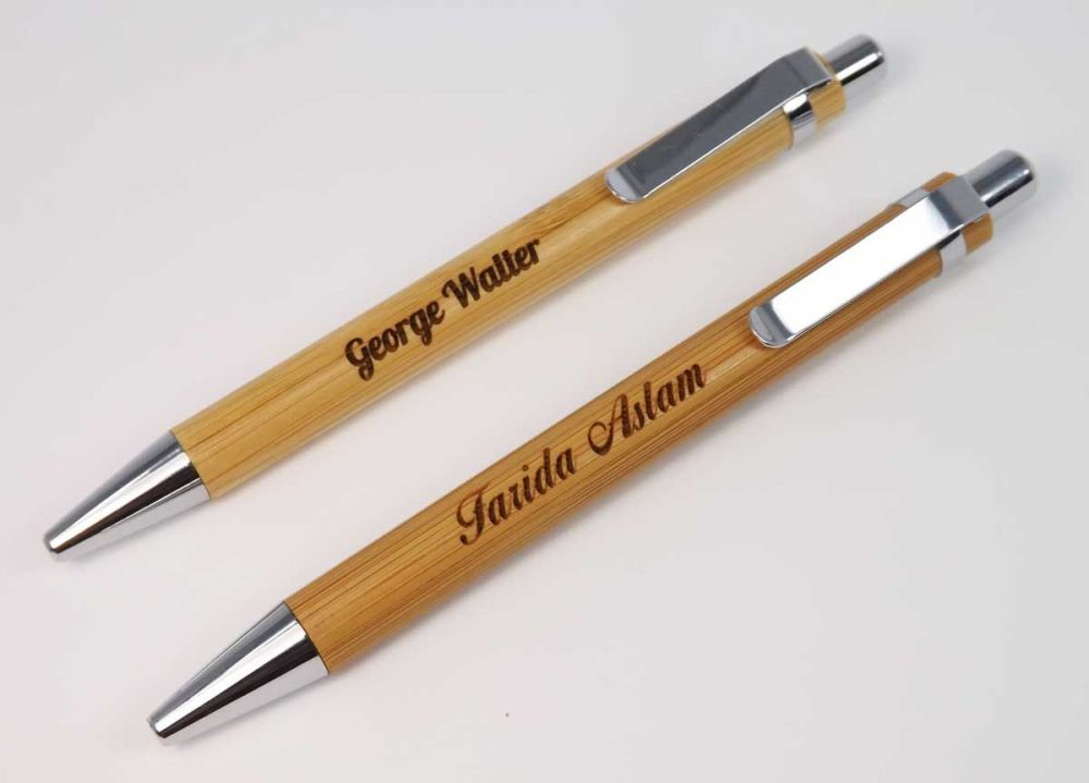Wooden push action ballpoint pen engraved with a techers or pupils name.