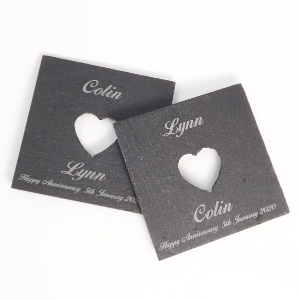 Slate coasters with a cut-out heart and personalised