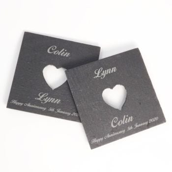 A Pair of Slate coasters with a cut-out heart and personalised