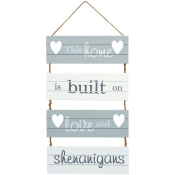 This home is built on shenanigans hanging wall sign