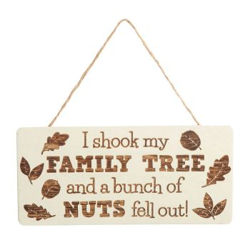 ' I shook my family tree ' sign with leaf detail