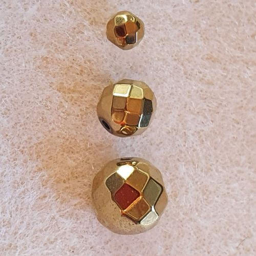 Golden Facetted Round Beads