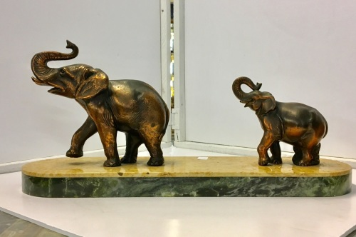 Elephants on marble base