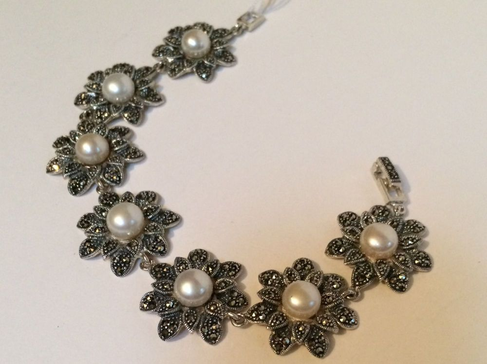 Silver and marcasite bracelet with pearls.