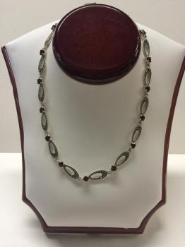 Silver and marcasite necklace with garnets.