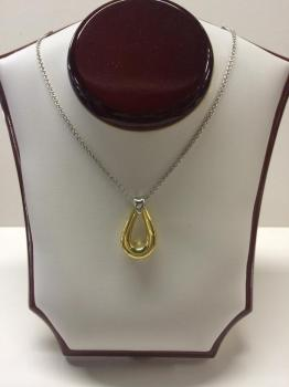 Silver necklace with gold accent pendant.
