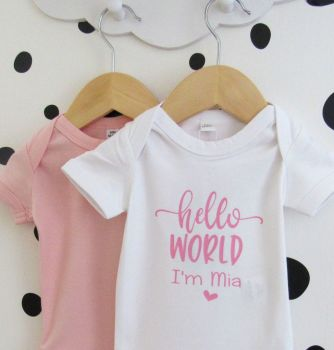 """Hello World I'm...."" personalised baby girl white 100% cotton body suit"