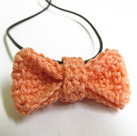 Peach pink bow tie necklace, 1 pc. (H80012)