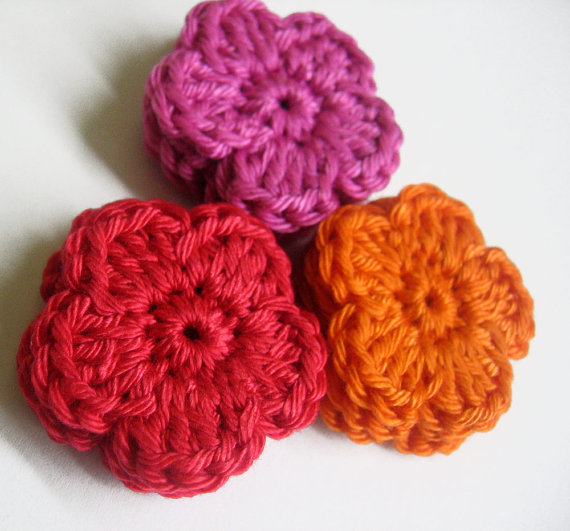 Crocheted flower appliques, pink, red orange, 9 pc.