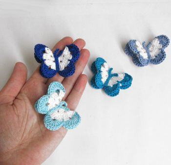 "Butterfly Appliques, 2"" wide, blue white mix, 4 pc. (A10139)"