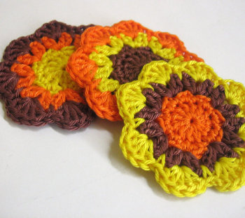 Handmade crocheted flower motif appliques in brown orange yellow 2,5 inches wide set of 3
