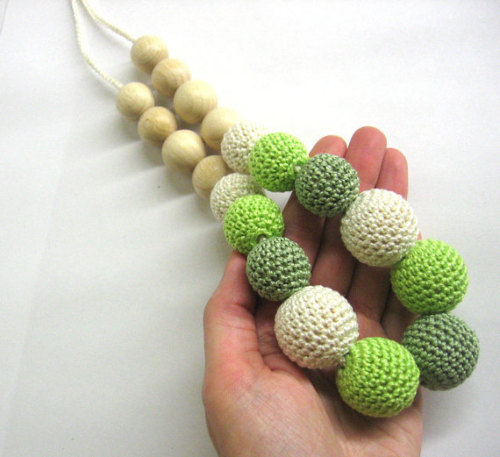 Nursing necklace with green and creem crocheted beads