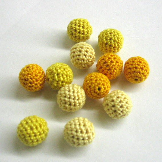 Yellow mix of crocheted beads, 12 pc.